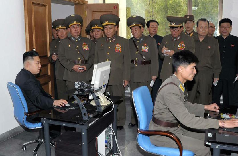 North Korean leader Kim Jong-un uses a computer at a military base. Hackers had access to Sony's internal network since at least July and may have had inside help in the cyberattack, a government official told our reporter. (KCNA photo)