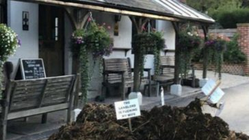 Cuckold Husband Gets Revenge With Pile of Manure and Sign