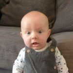 8-Week-Old Baby Lula Watches Strongman Vids, Stands